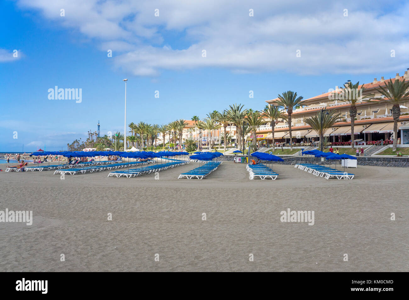 Sunbeds and parasols at the beach, Los Christianos, Tenerife island, Canary islands, Spain - Stock Image