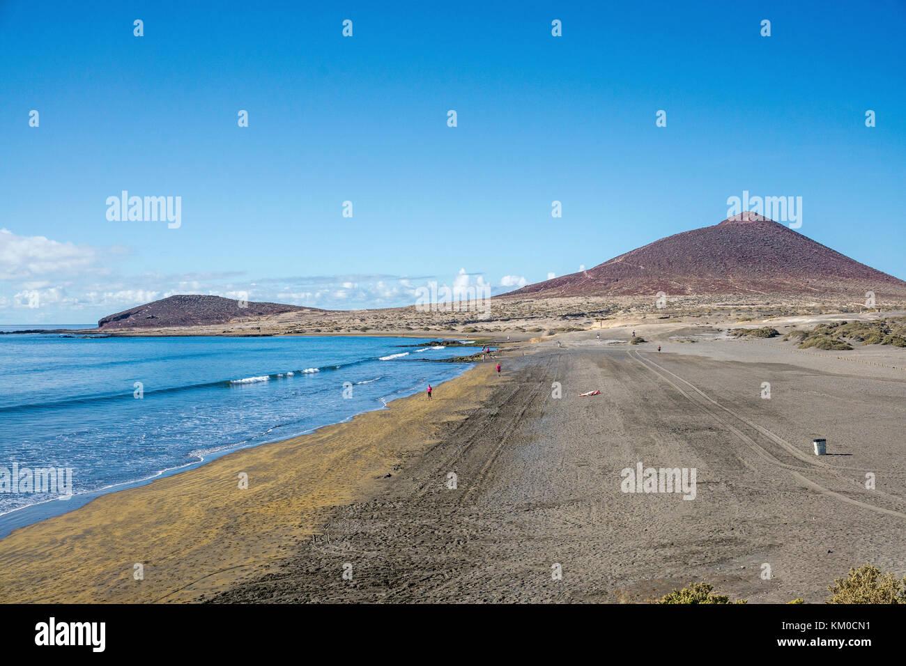 El Medano, popular beach for surfers and Montana Roja, Tenerife island, Canary islands, Spain - Stock Image