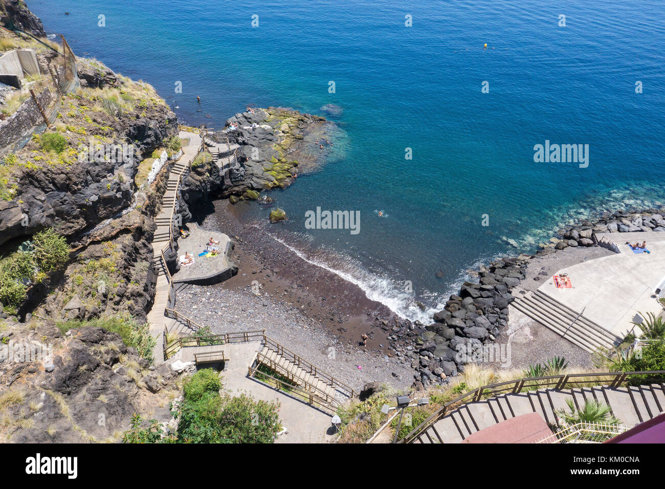 View from a Appartment skyscrapper down to a small dark beach,Tabaiba, Tenerife island, Canary island, Spain - Stock Image