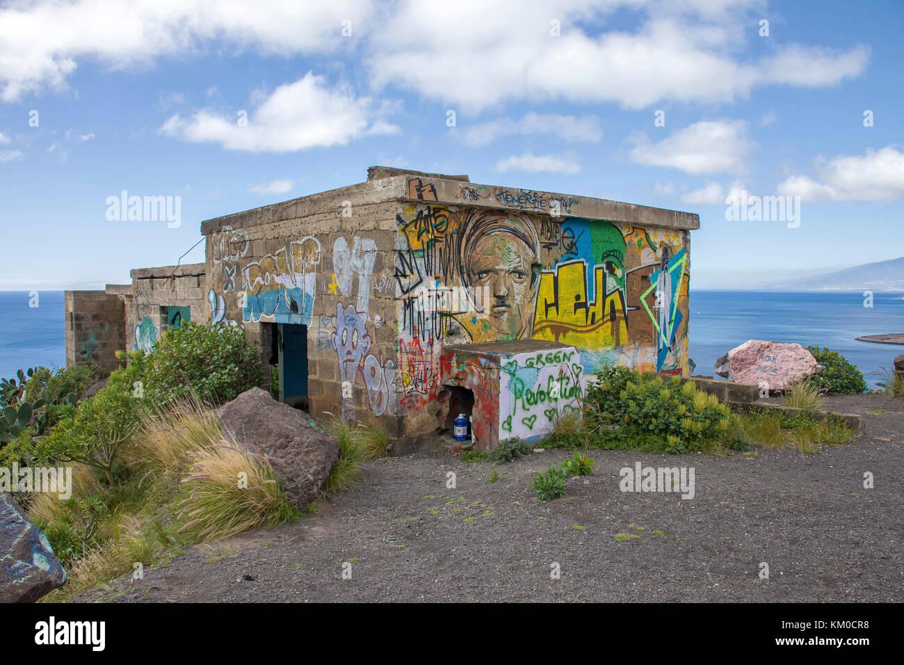 Painted construction ruins above the popular beach Playa Teresitas, San Andres, Tenerife island, Canary islands, - Stock Image