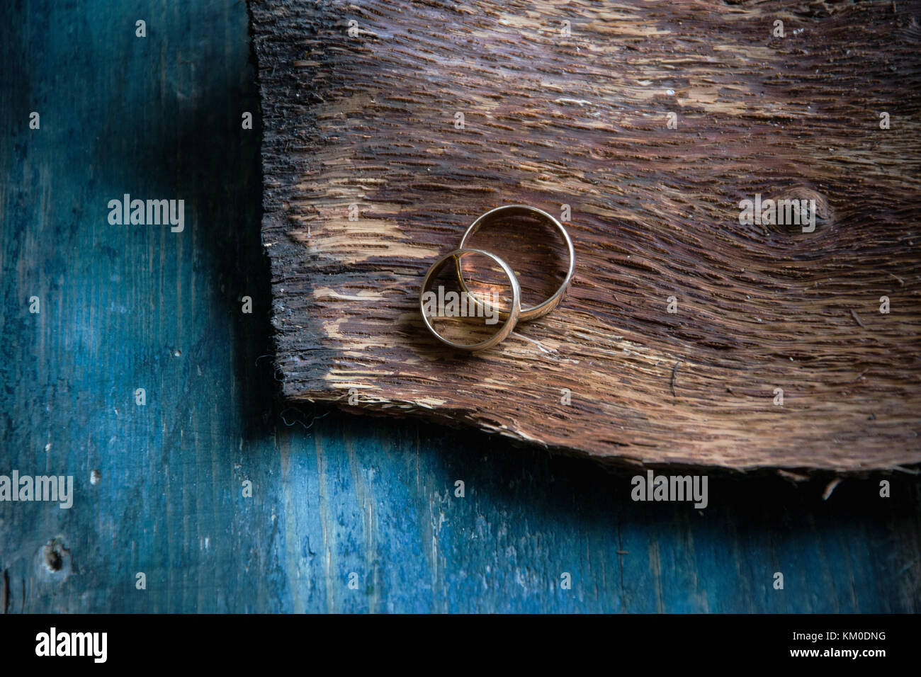 Two Wedding Rings On Rustic Wooden Background