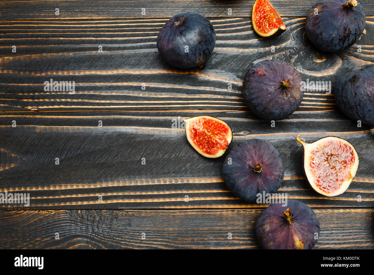 Figs on wooden background - Stock Image
