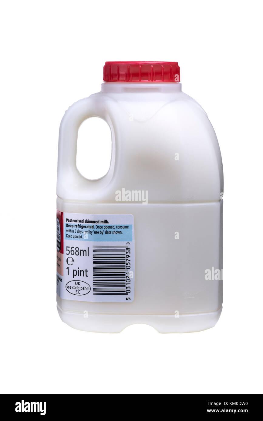 Pint bottle red top skimmed milk. - Stock Image