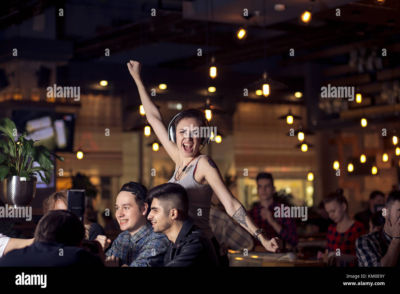friends having a coffee together. women and man at cafe, talking, laughing - Stock Image