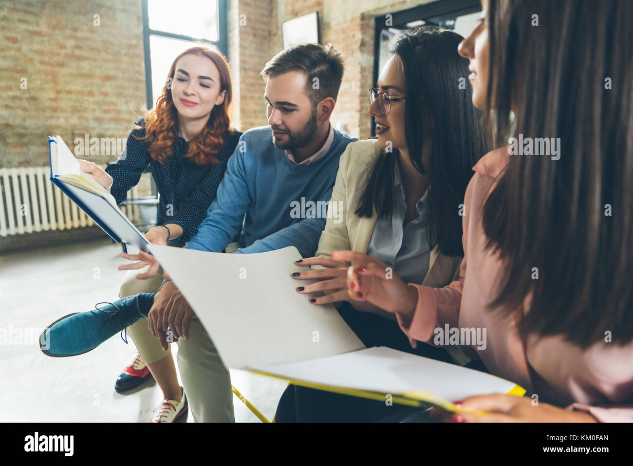 Job candidates braging with their resumes Stock Photo