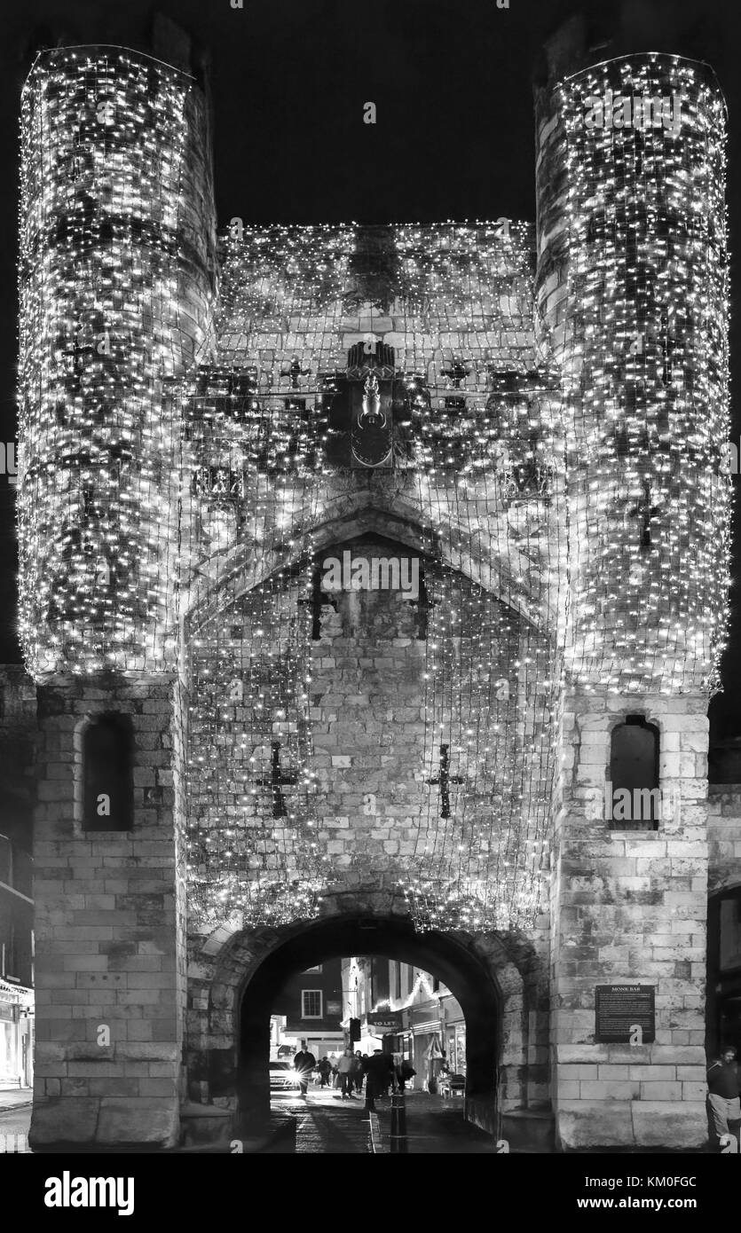 Shimmering lights over Monk Bar welcoming visitors to York, UK - Stock Image