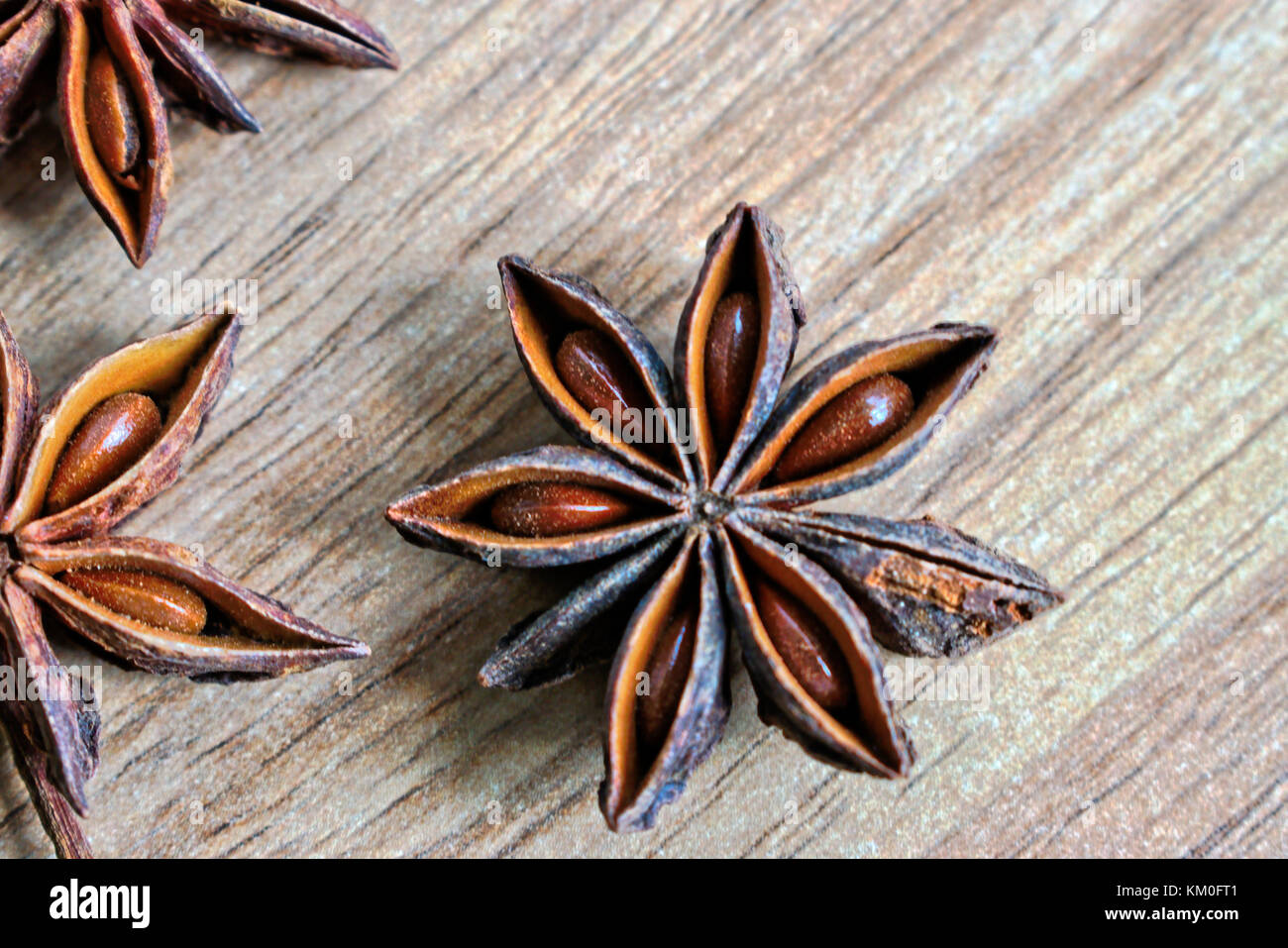 Closeup of star shaped anise on a wooden table - Stock Image