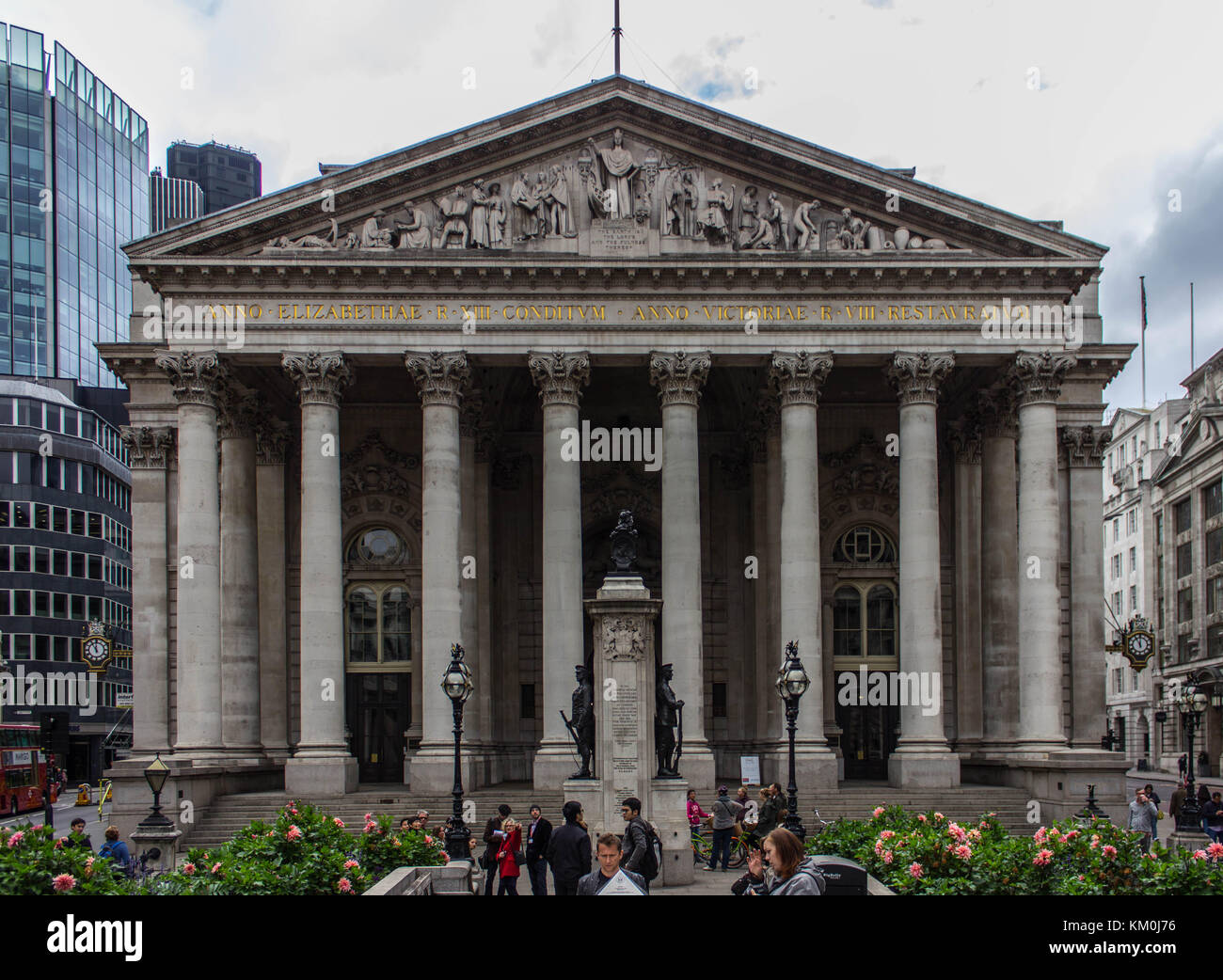 The Palladian style entrance of the Royal Exchange building in London. It has amazing engravings at the top of it - Stock Image