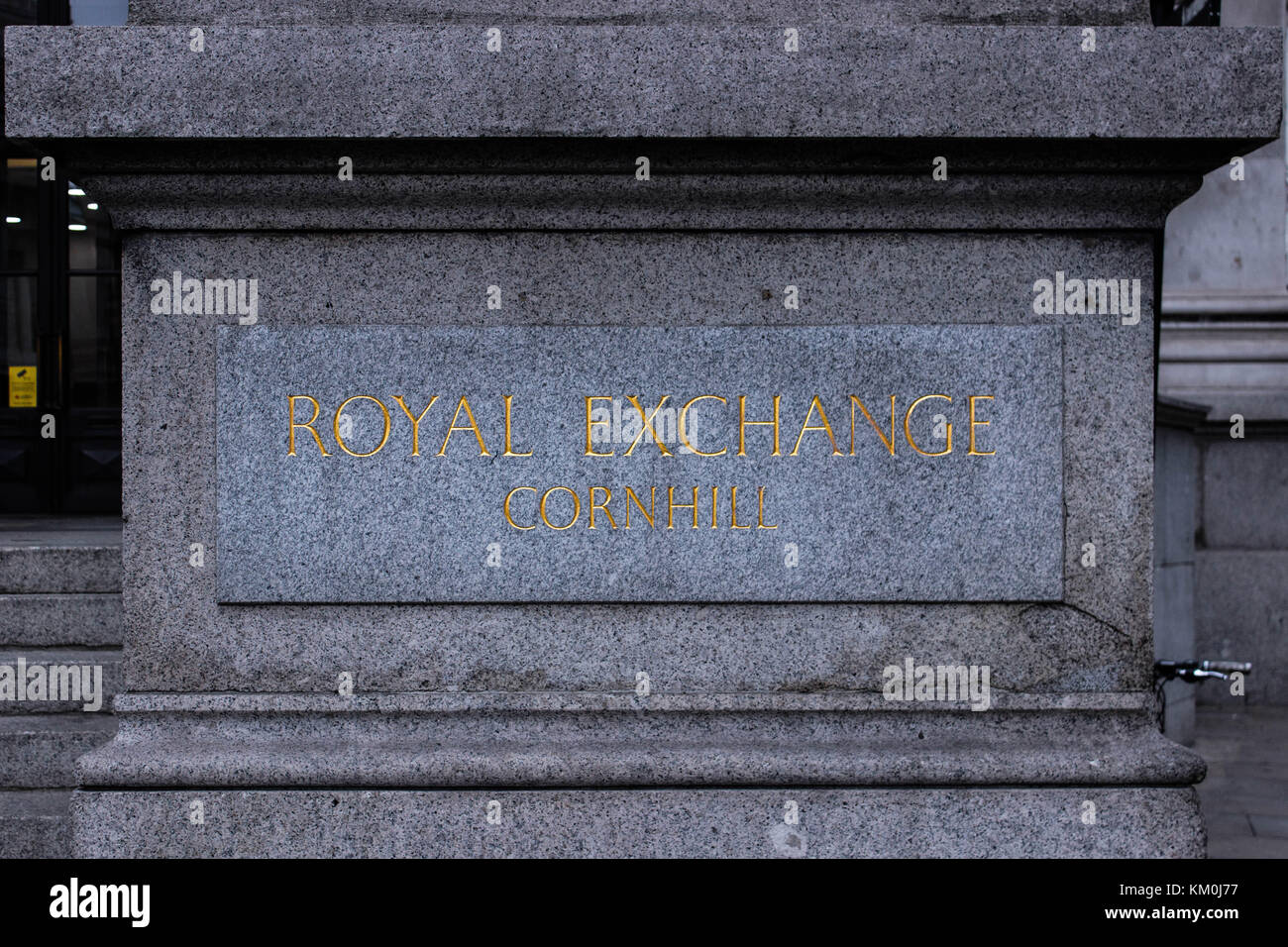 Shot of the Royal Exchange engraving right at its entrance, golden letters and beautiful stone. It is at the Palladian - Stock Image