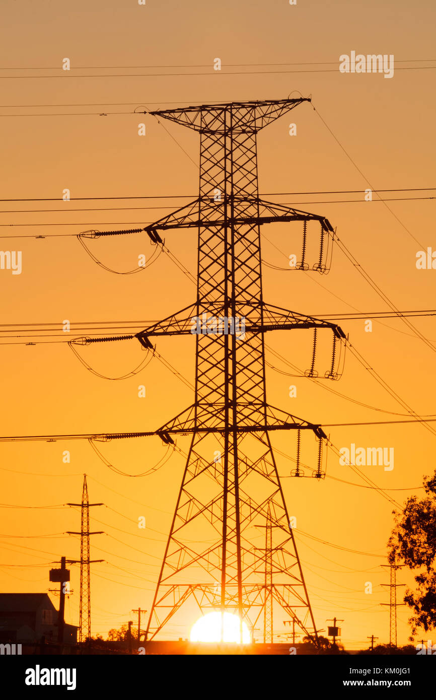Electrical grid in modern city. Climate change is forcing change to green energy base load power but the power grid Stock Photo