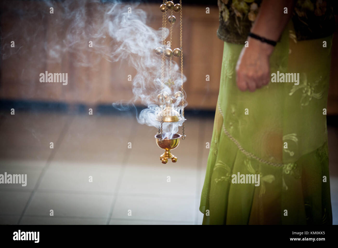 The woman holding the incense - Stock Image