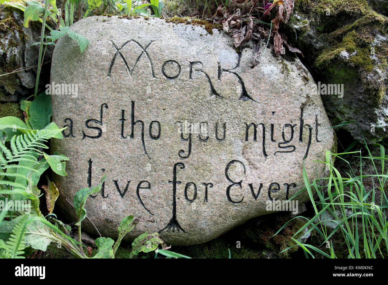 "A stone with the aphorism ""Work as tho' you might live for Ever"" - Stock Image"