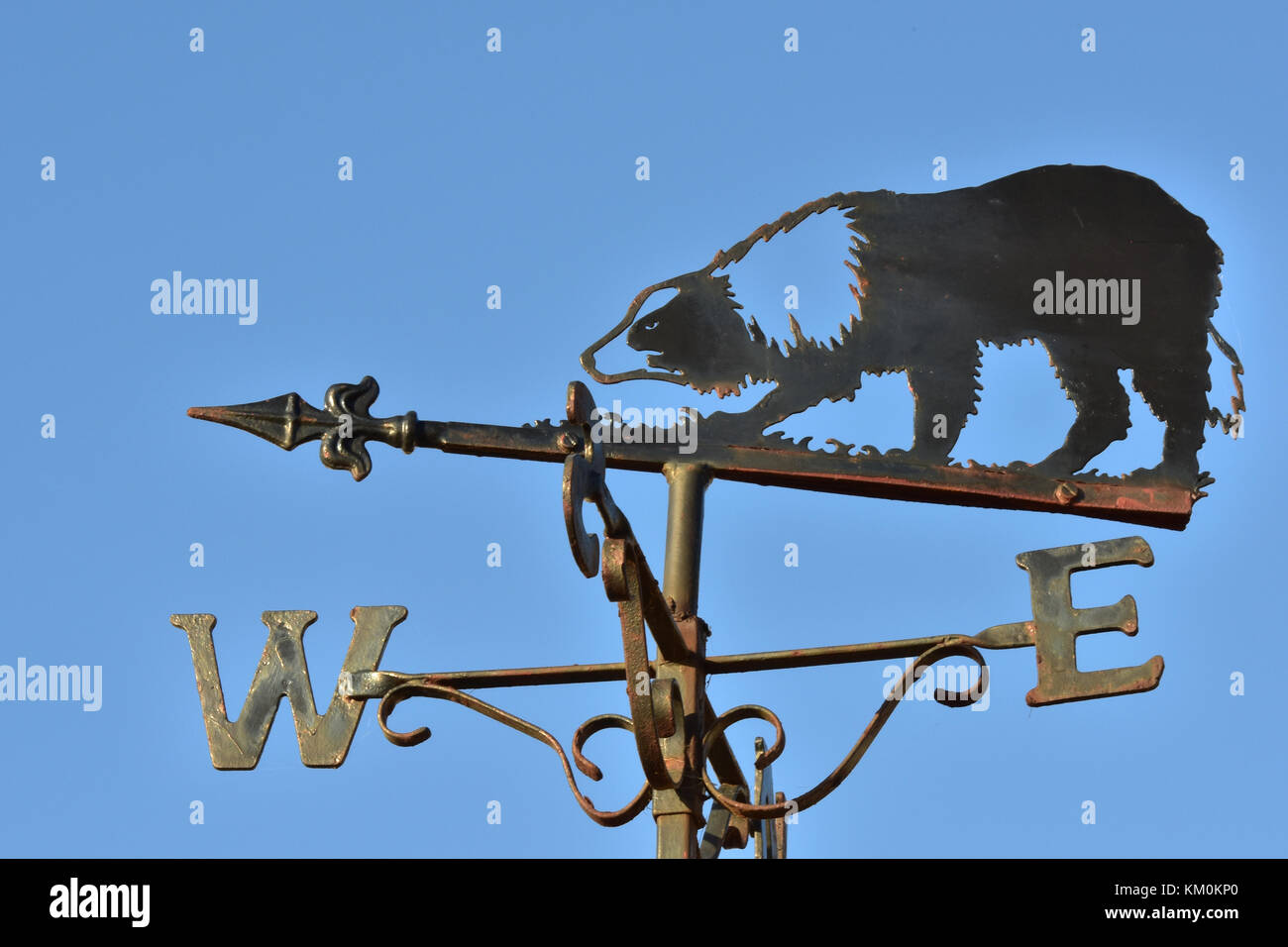 A border collie or sheep dog depicted on a weather vane for telling the direction of the prevailing weather or wind. - Stock Image