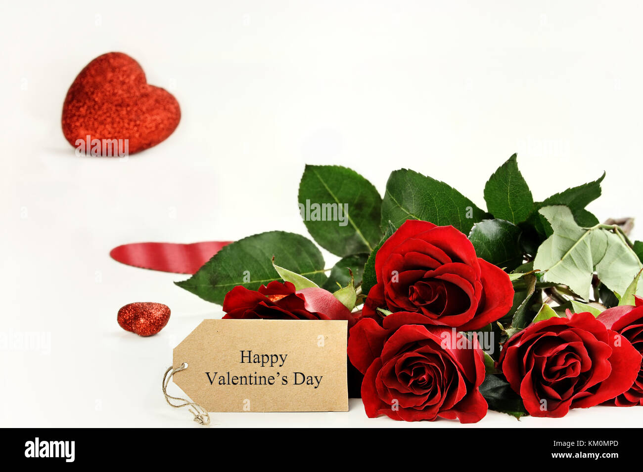 Red Roses With An Happy Valentines Day Label And Glitter Hearts In
