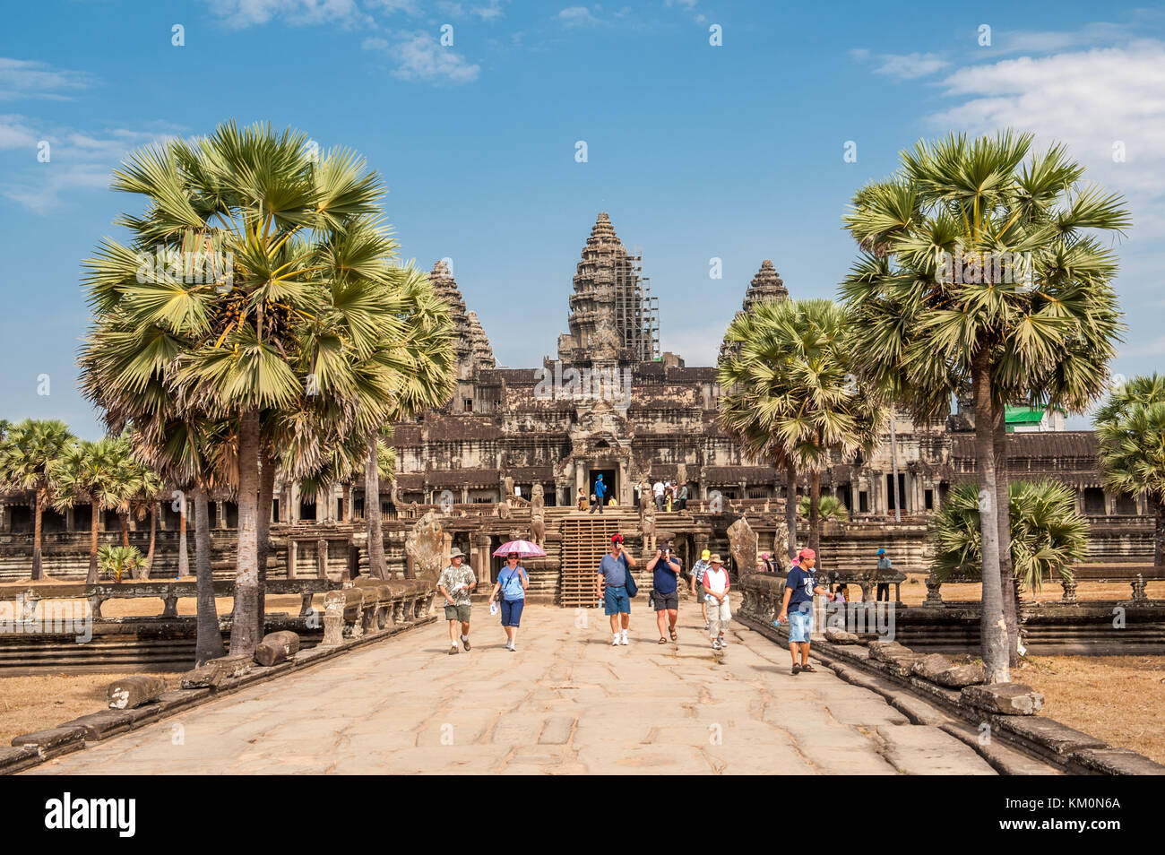 Tourists at Angkor Wat in Siem Reap, Cambodia. Angkor Wat is a 12th century temple and a world famous UNESCO World - Stock Image
