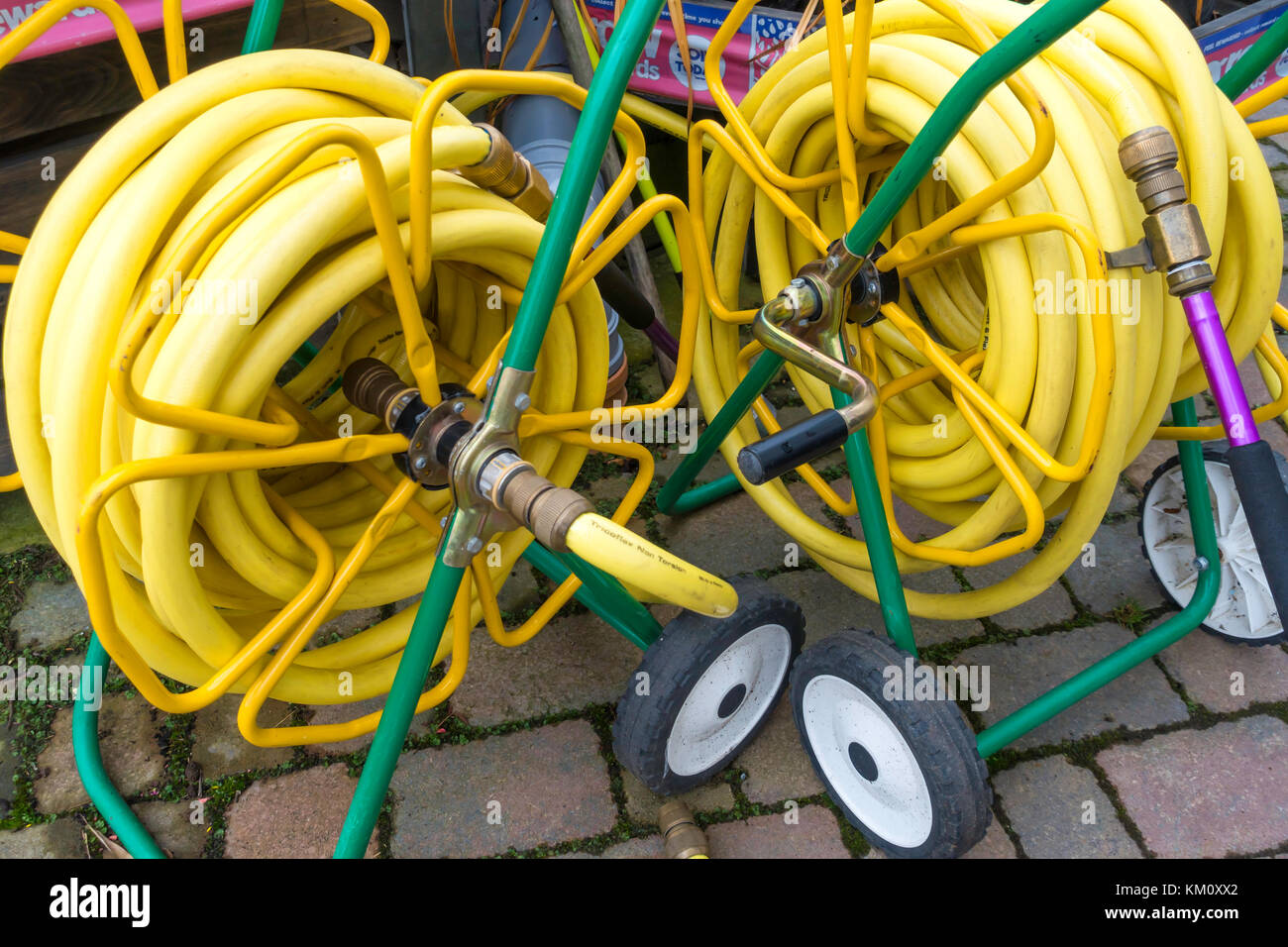 Wonderful Two Market Garden Hose Reels With Yellow Kink Resisting Hose On Portable  Reels And Having Spray