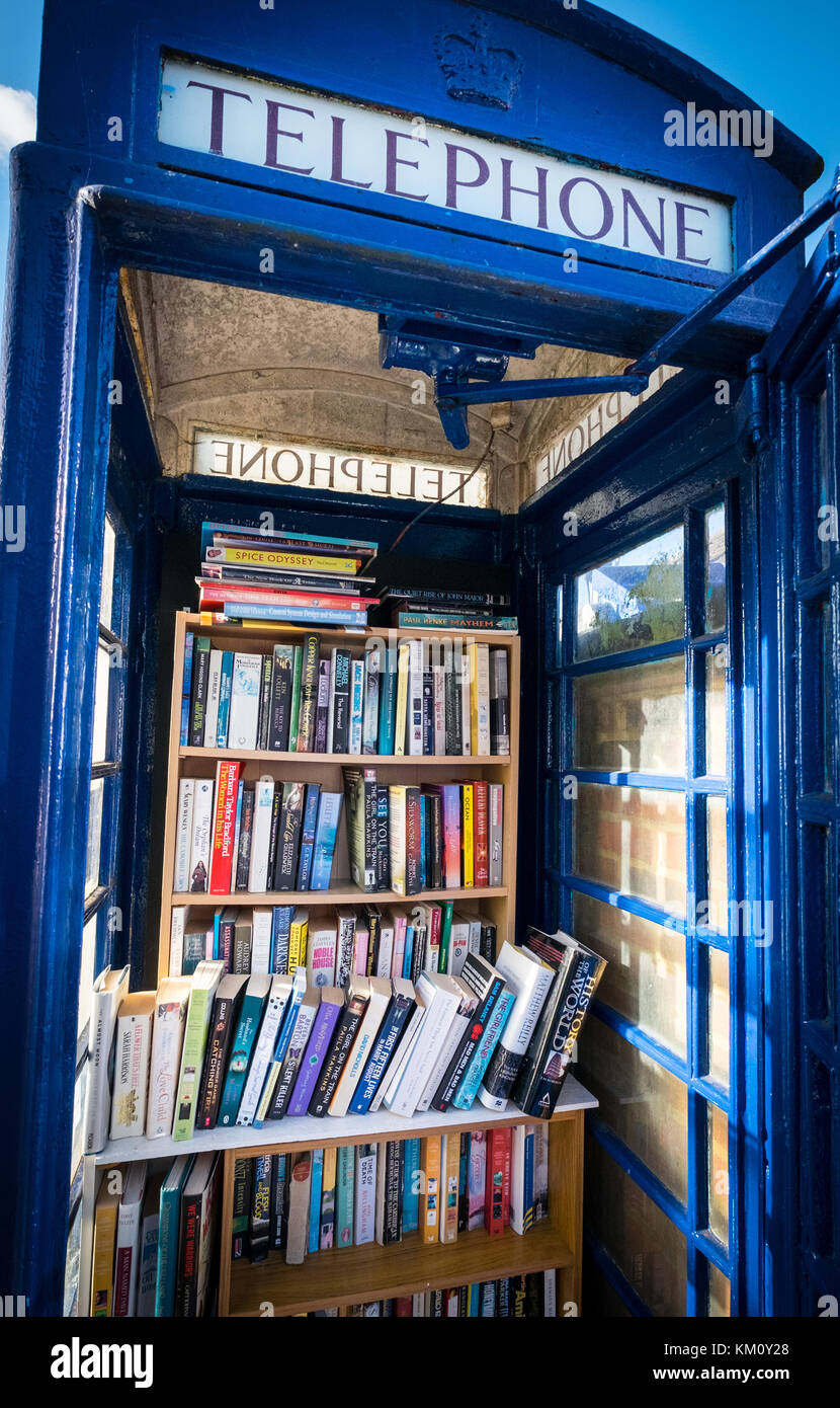 A book exchange community book library set up in an old BT Telephone box to help people recycle books - Stock Image