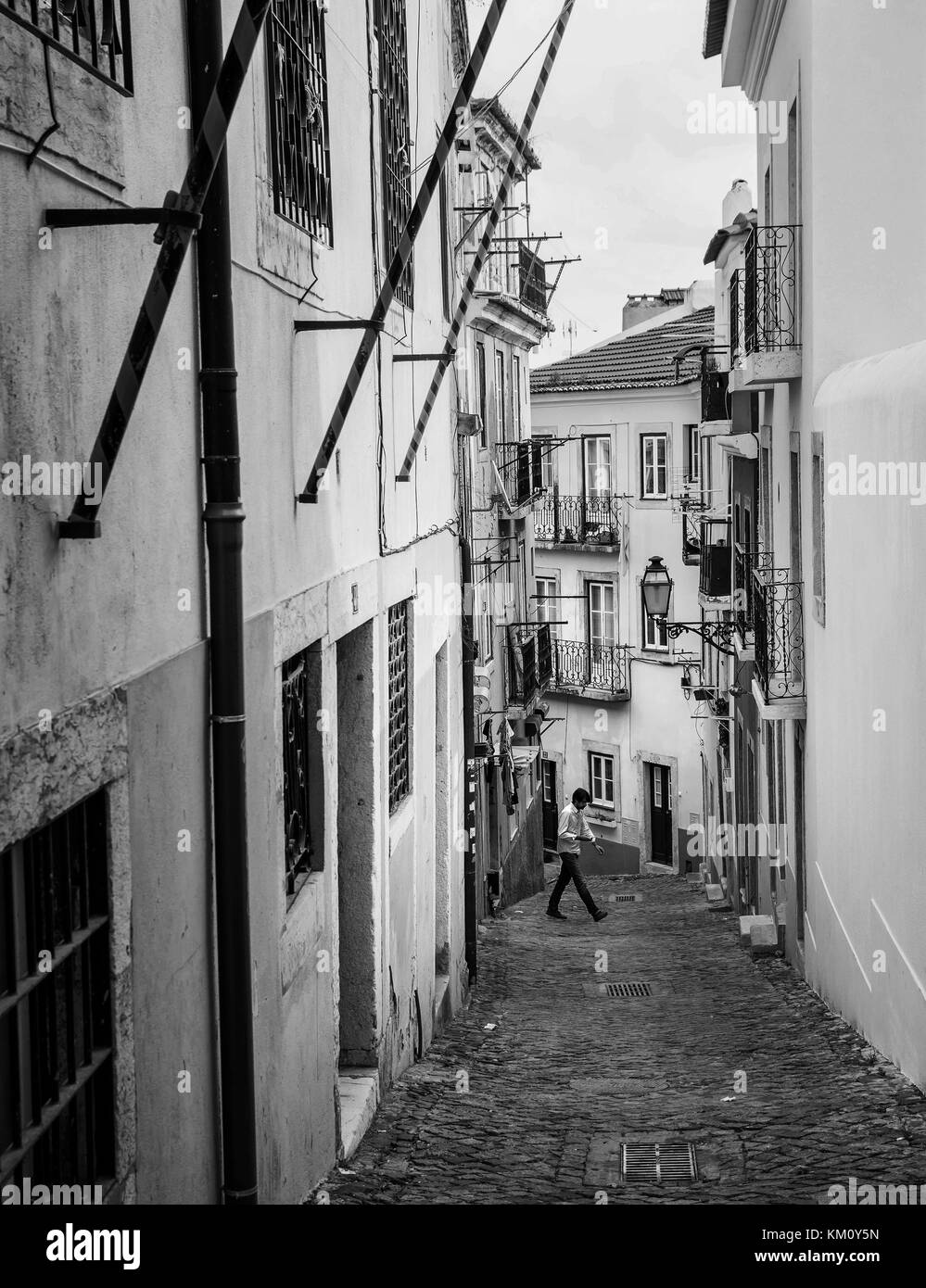 Colorful street in Alfama quarter, old picturesque part of Lisbon, Capital of Portugal - Stock Image