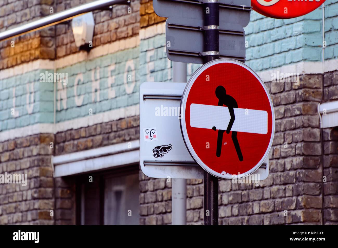 Art sticker on no entry sign in Brick Lane. London, 2016. Landscape format. - Stock Image