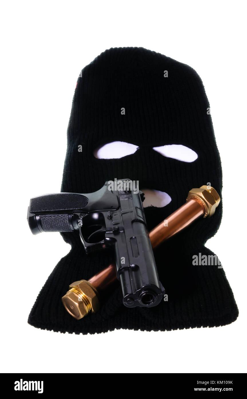 Pipebomb, handgun and balaclava - Stock Image