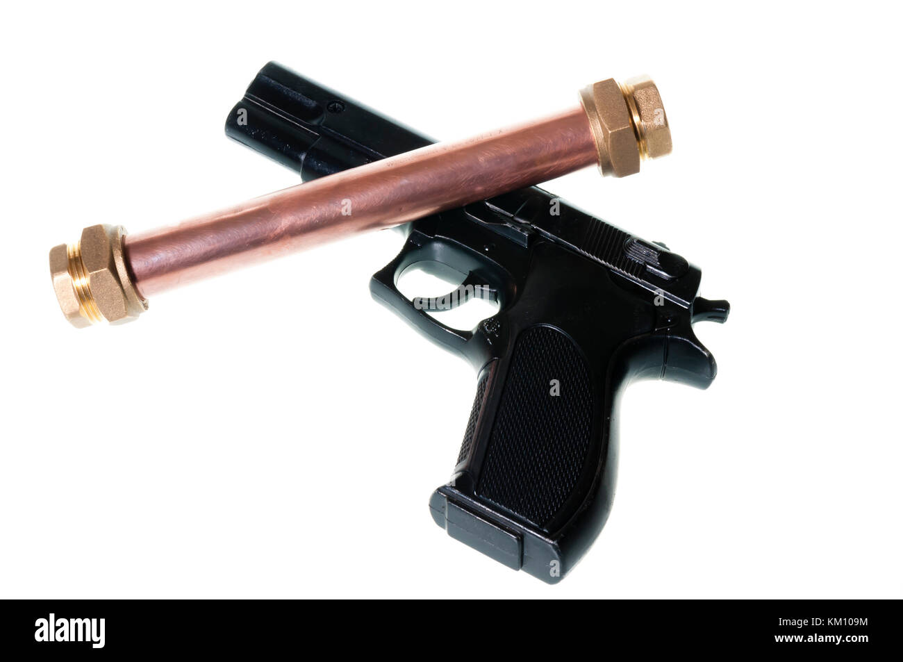 Pipebomb and handgun - Stock Image