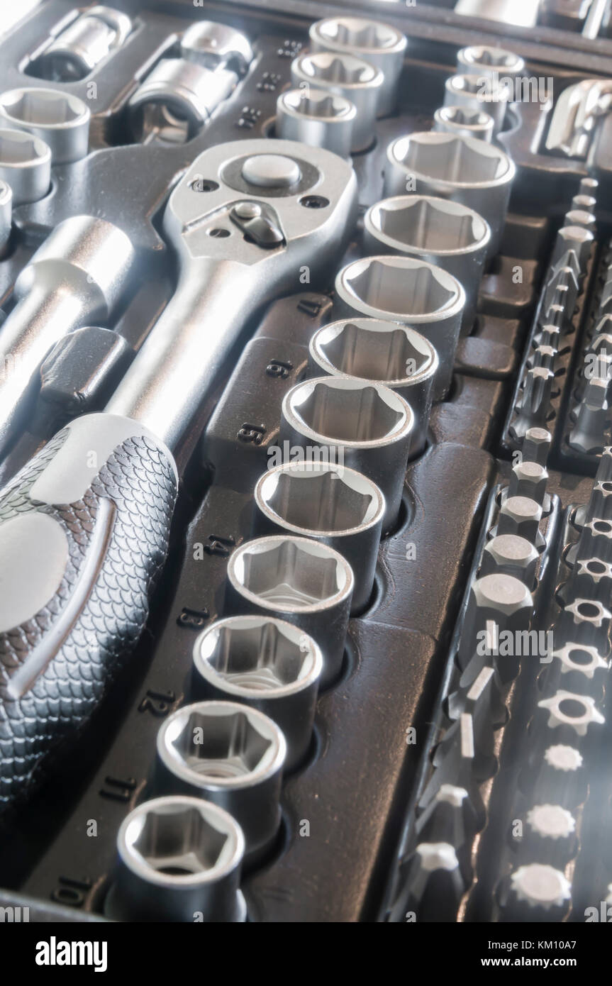 Sockets, tools, wrenches, spanners and bits in a chrome vanadium socket set. Stock Photo