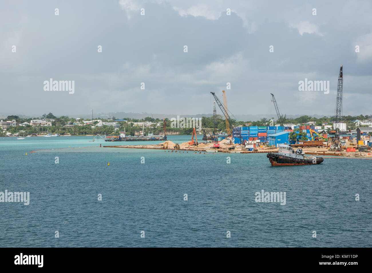 PORT VILA, VANUATU, PACIFIC ISLANDS-DECEMBER 1,2016: Industrial commercial port with construction equipment and - Stock Image