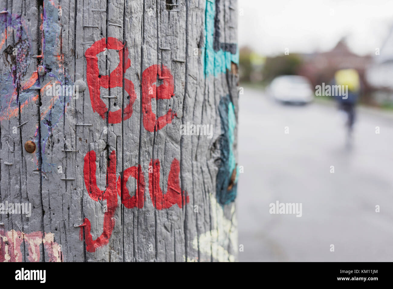 Be you painted on power pole.   Victoria BC Canada - Stock Image