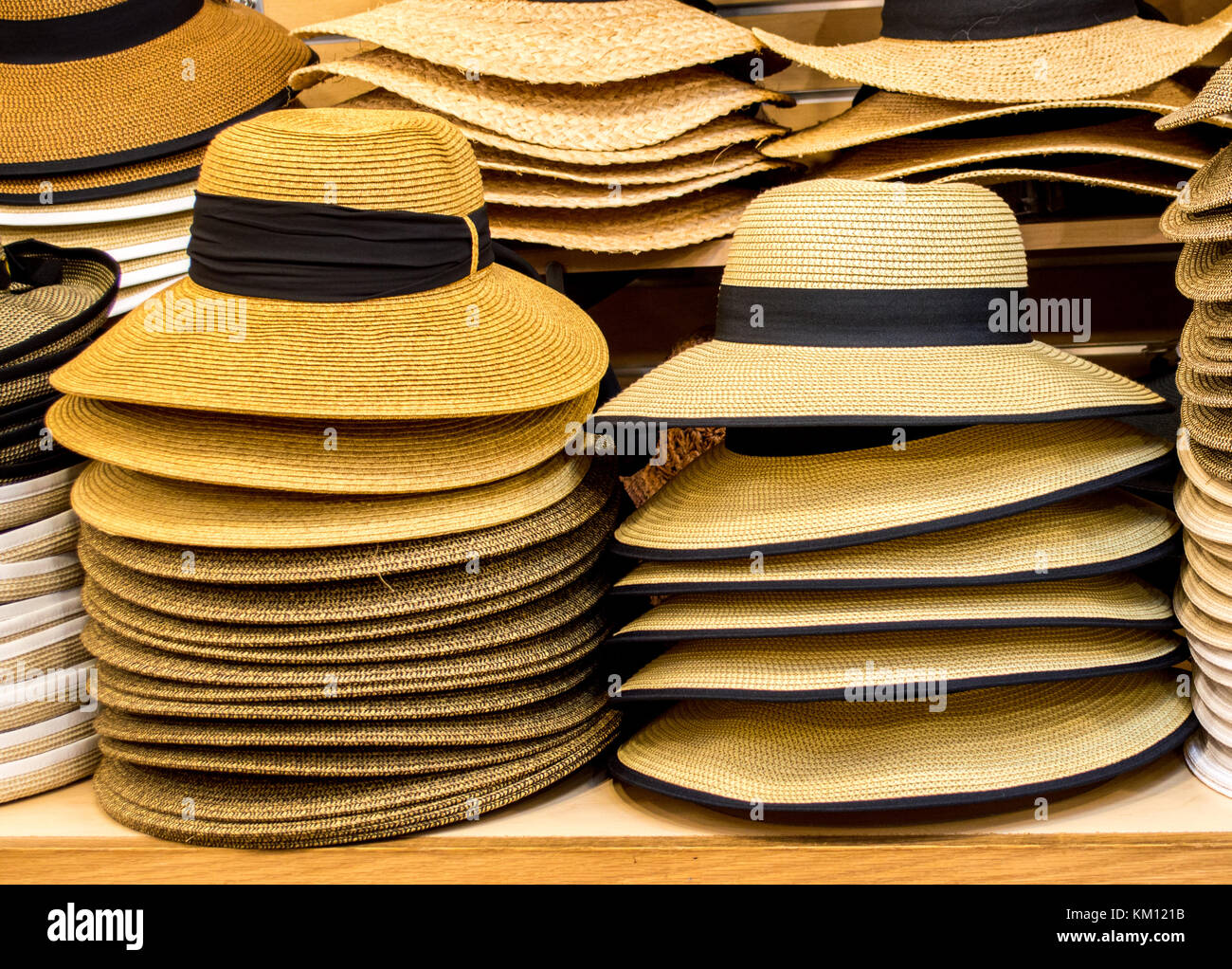 b0e60906785c81 rows of colorful sun hats and Panama hats stacked on shelves in a hat shop -