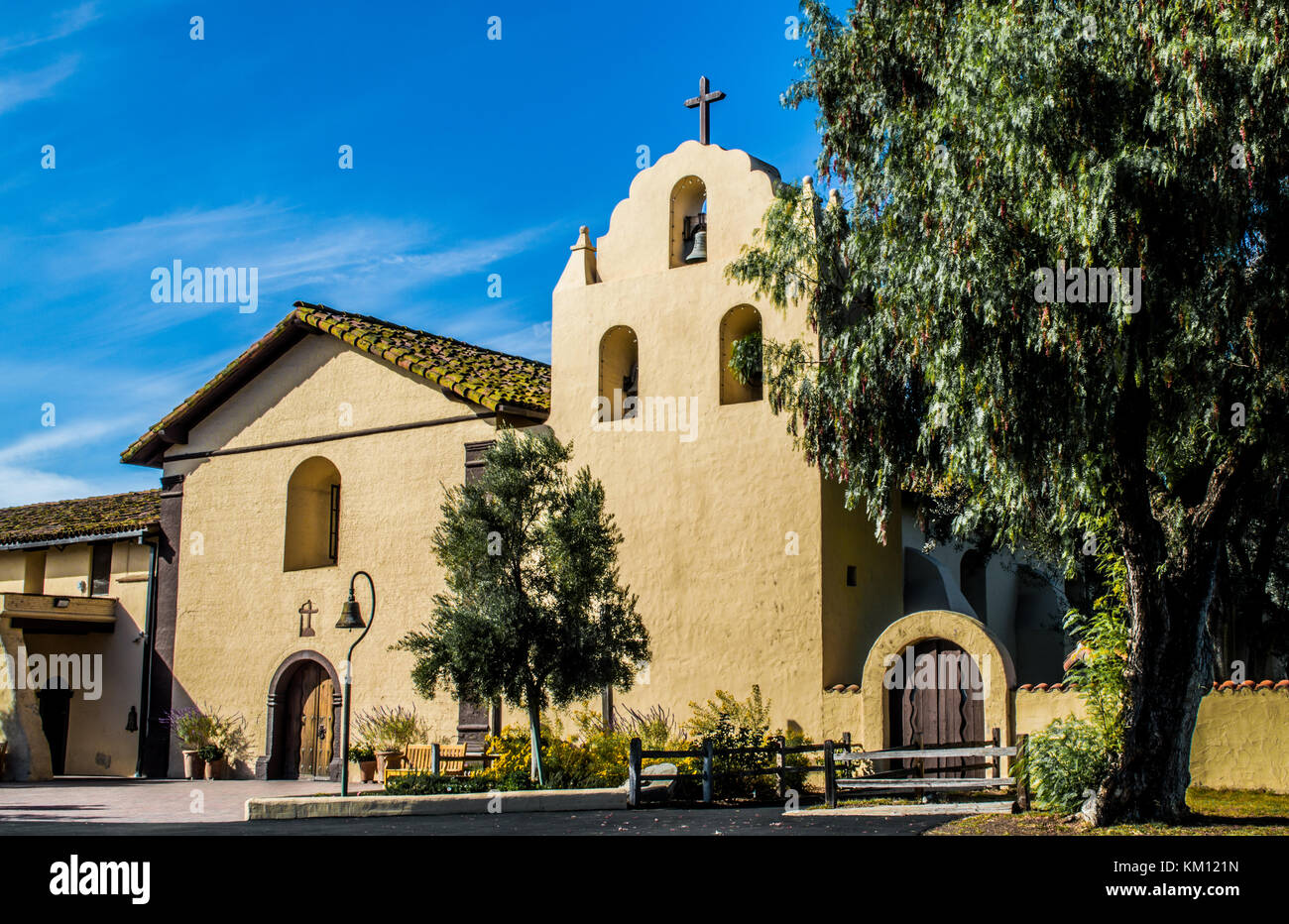 exterior of Santa Ines mission and grounds in Solvang, California, US with early morning sunlight - Stock Image