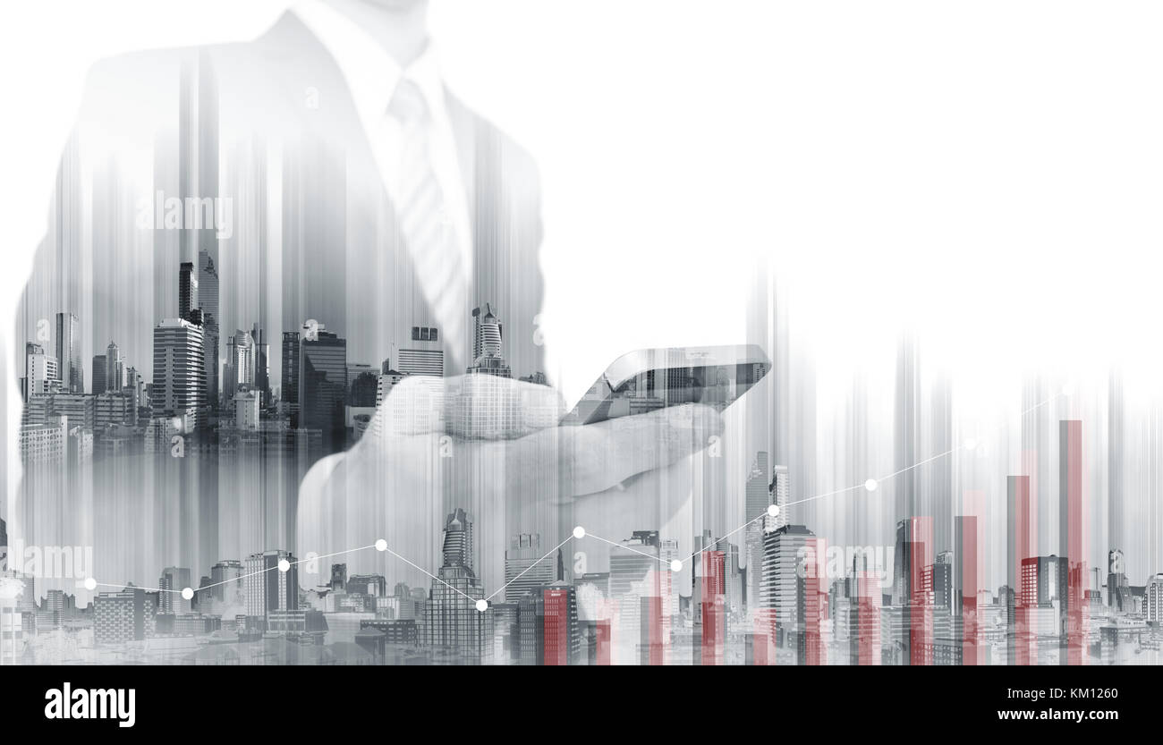 Double exposure Businessman using mobile smart phone with modern buildings. Business growth and investment - Stock Image