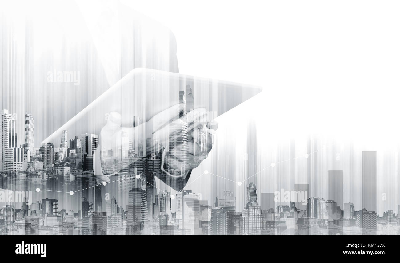 Double exposure Businessman working on digital tablet with modern buildings. Business growth and investment - Stock Image