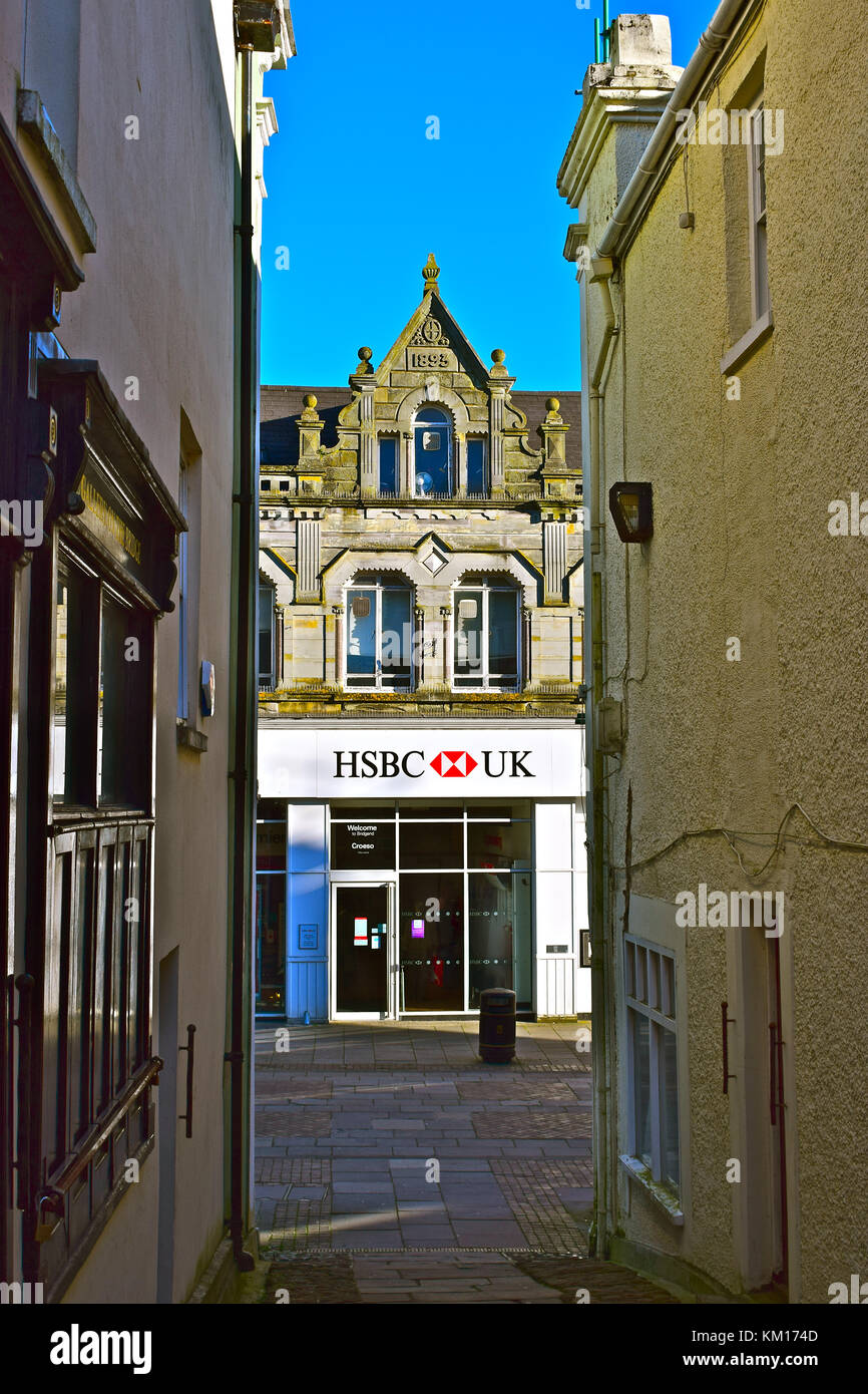 HSBC Bridgend Branch in old town centre building which dates back to 1893. It is viewed from the old stone bridge - Stock Image