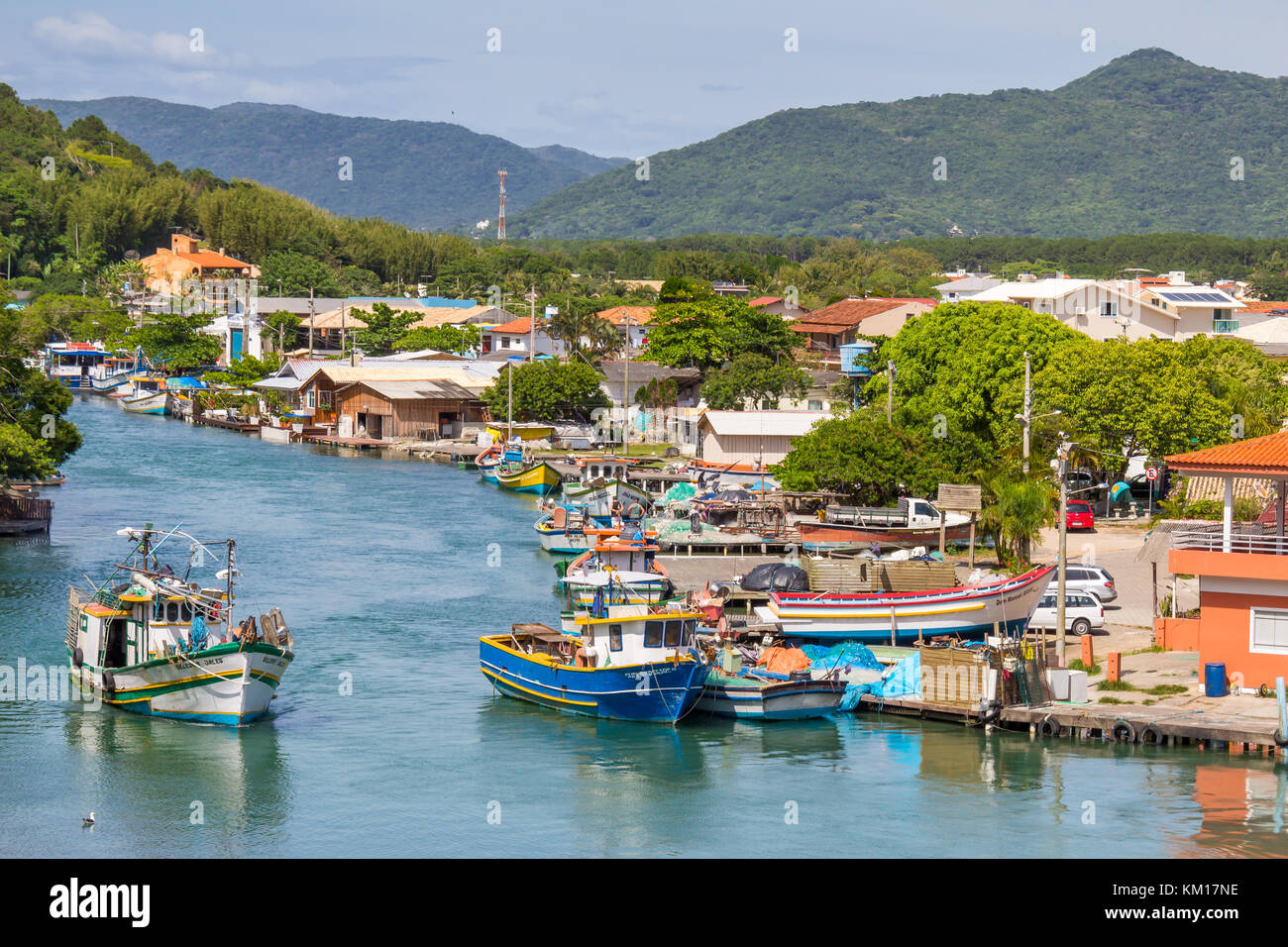 Fisher boats in the canal which connects the ocean and the lagoon at Barra da Lagoa | Florianópolis | Brazil - Stock Image