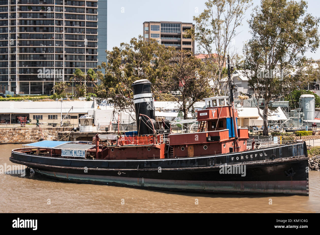 Brisbane, Australia - December 8, 2009: Old black and red small steam towboat named Forceful docked at Maritime - Stock Image