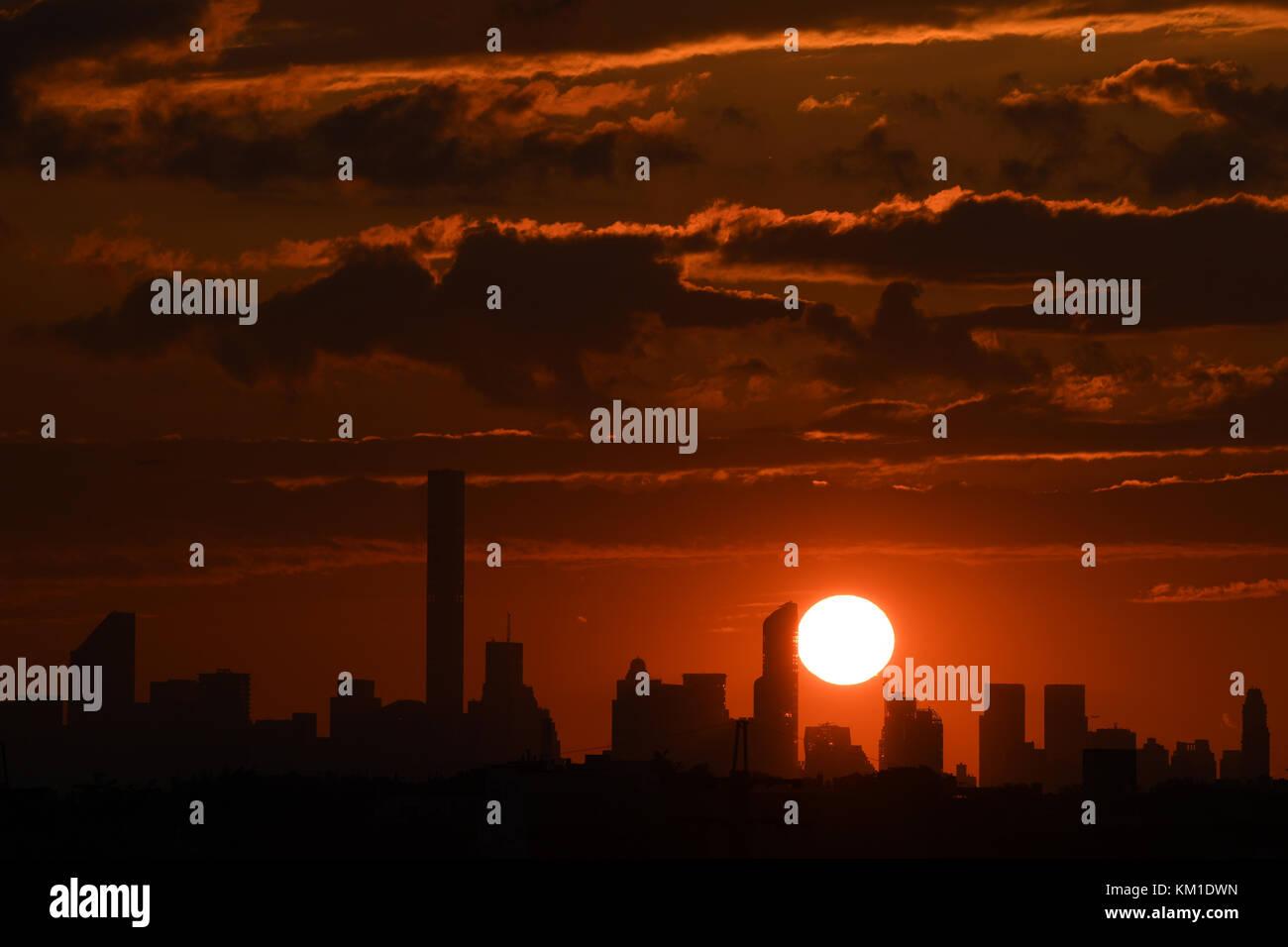 FLUSHING NY- SEPTEMBER 01: Sunset over the Manhattan skyline from Arthur Ashe Stadium at the USTA Billie Jean King - Stock Image