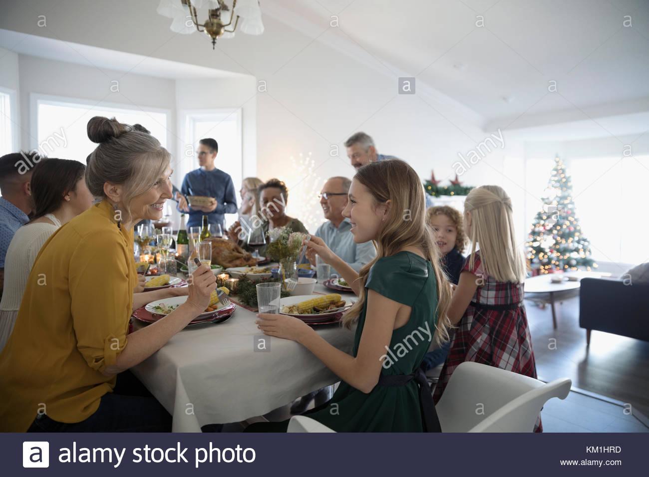 Multi-generation family enjoying Christmas dinner at table - Stock Image