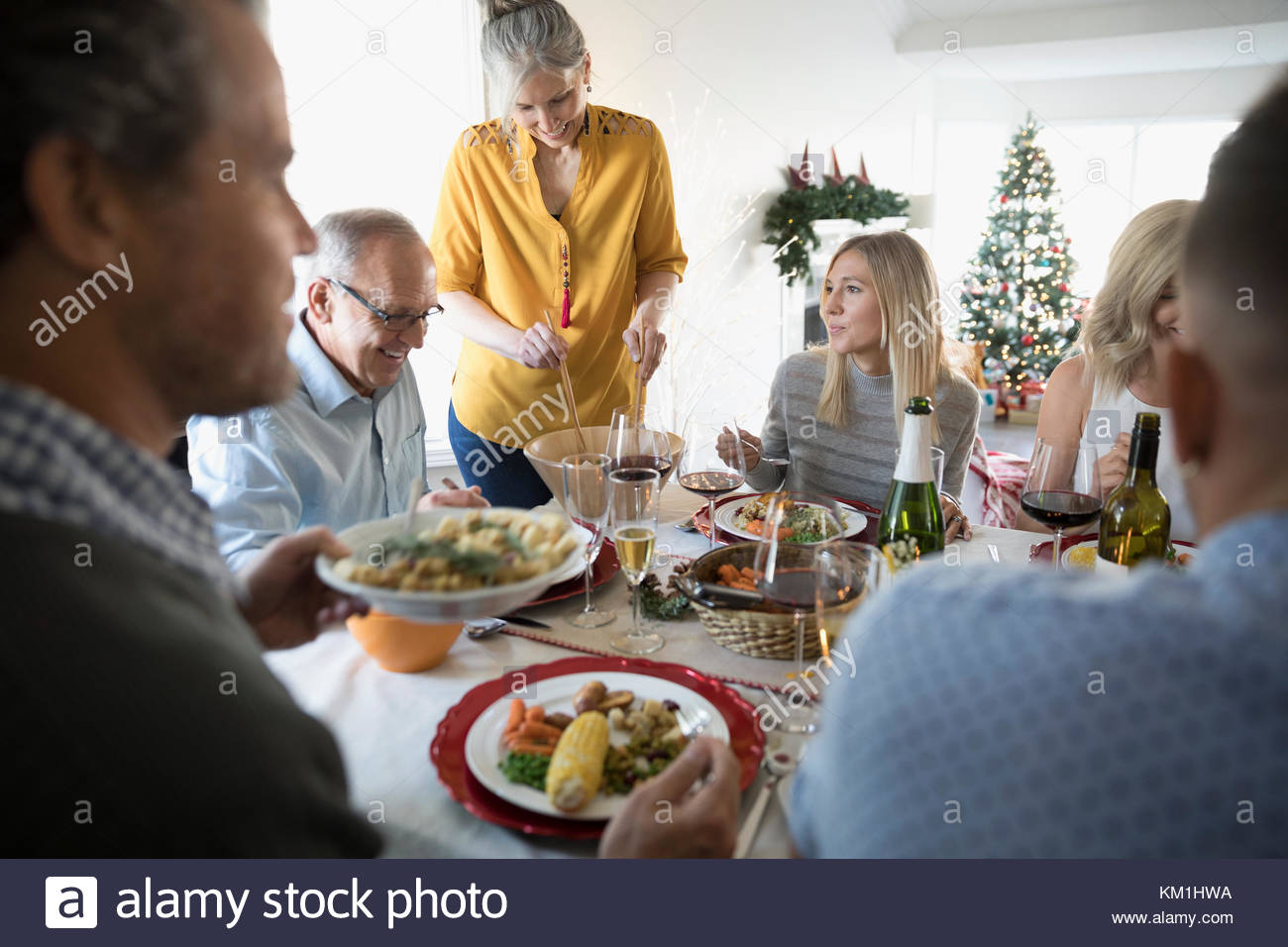 Family enjoying Christmas dinner at table - Stock Image