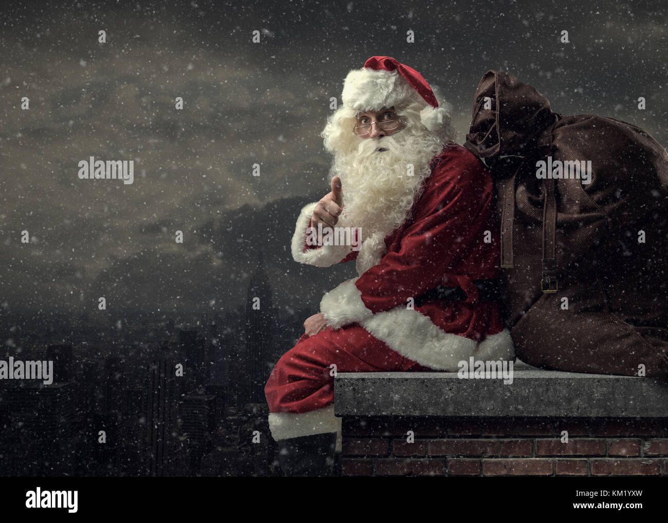 8d5842b795309 Happy Santa Claus bringing gifts on Christmas Eve  he is sitting on a roof