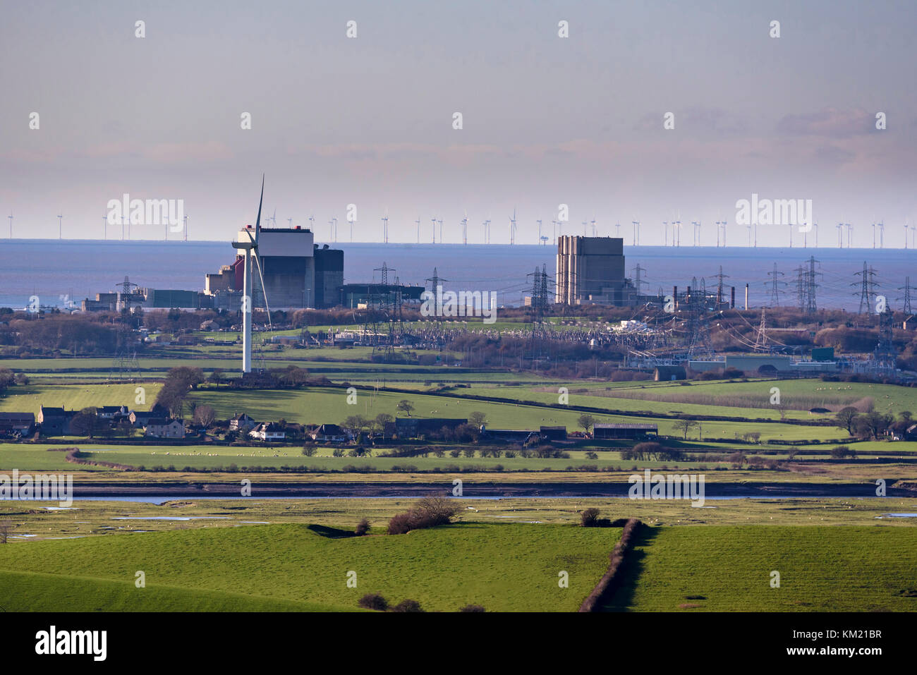 Heysham nuclear power stations. Windmills in Morecambe Bay. - Stock Image
