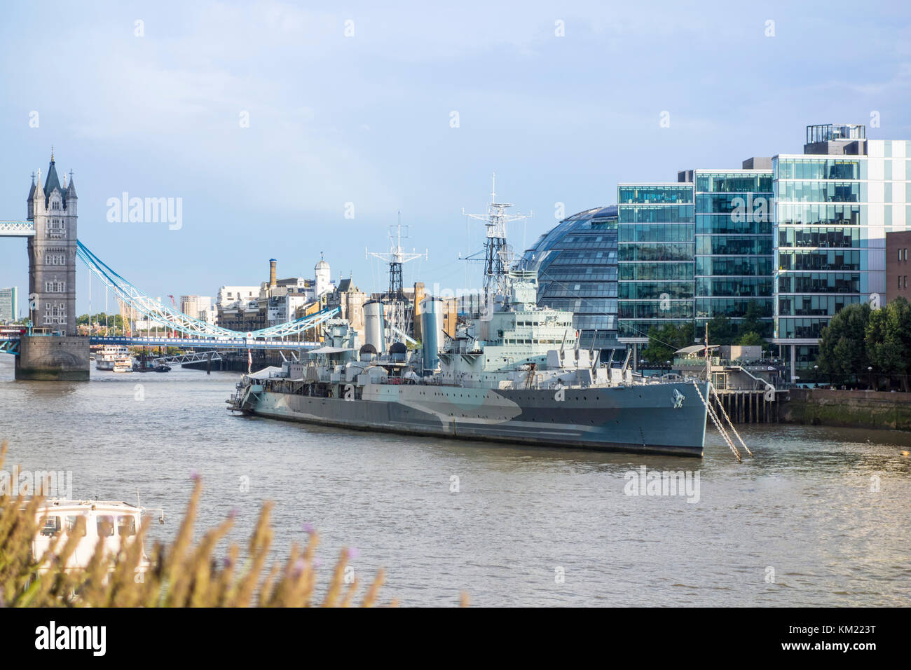 HMS Belfast WWII warship now a museum moored on the River Thames, London, UK - Stock Image