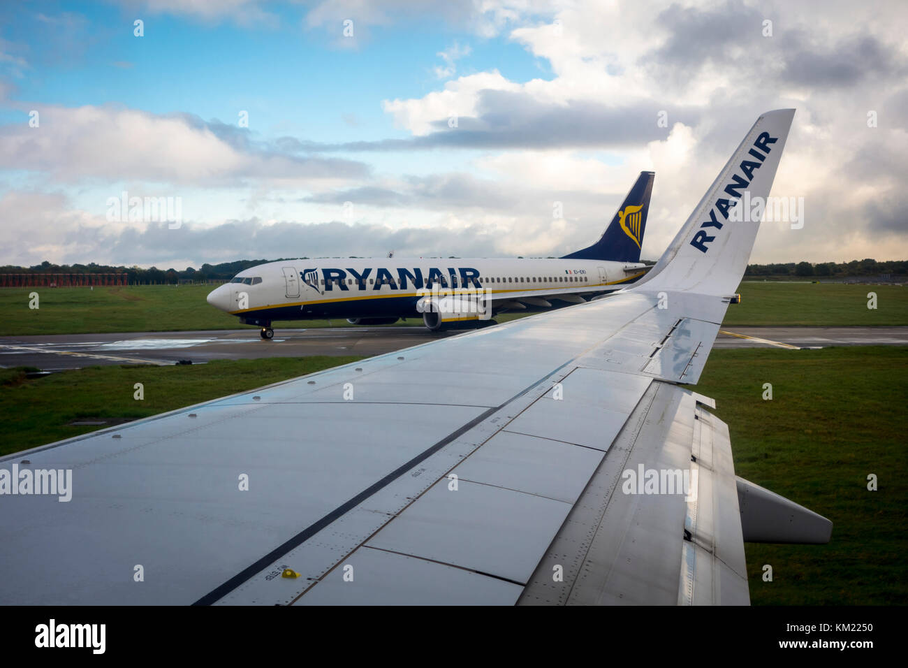 View of a Ryanair plane, aeroplane, airplane, waiting to enter the runway from inside another plane, Stansted Airport, - Stock Image