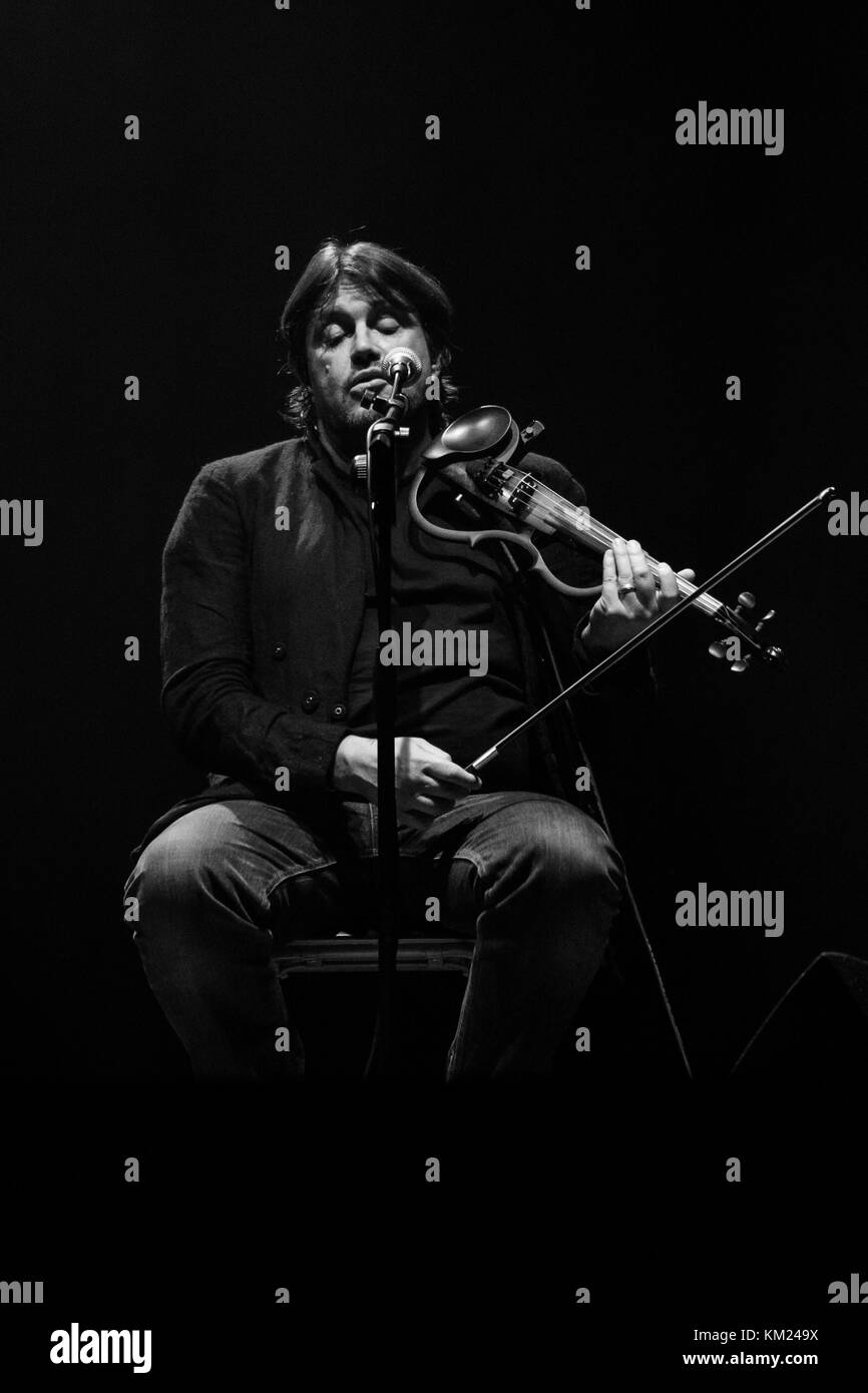 Vigevano, Italy. 2st December, 2017. Cristiano De Andre plays an electric violin during a live performance. Credit: Stock Photo