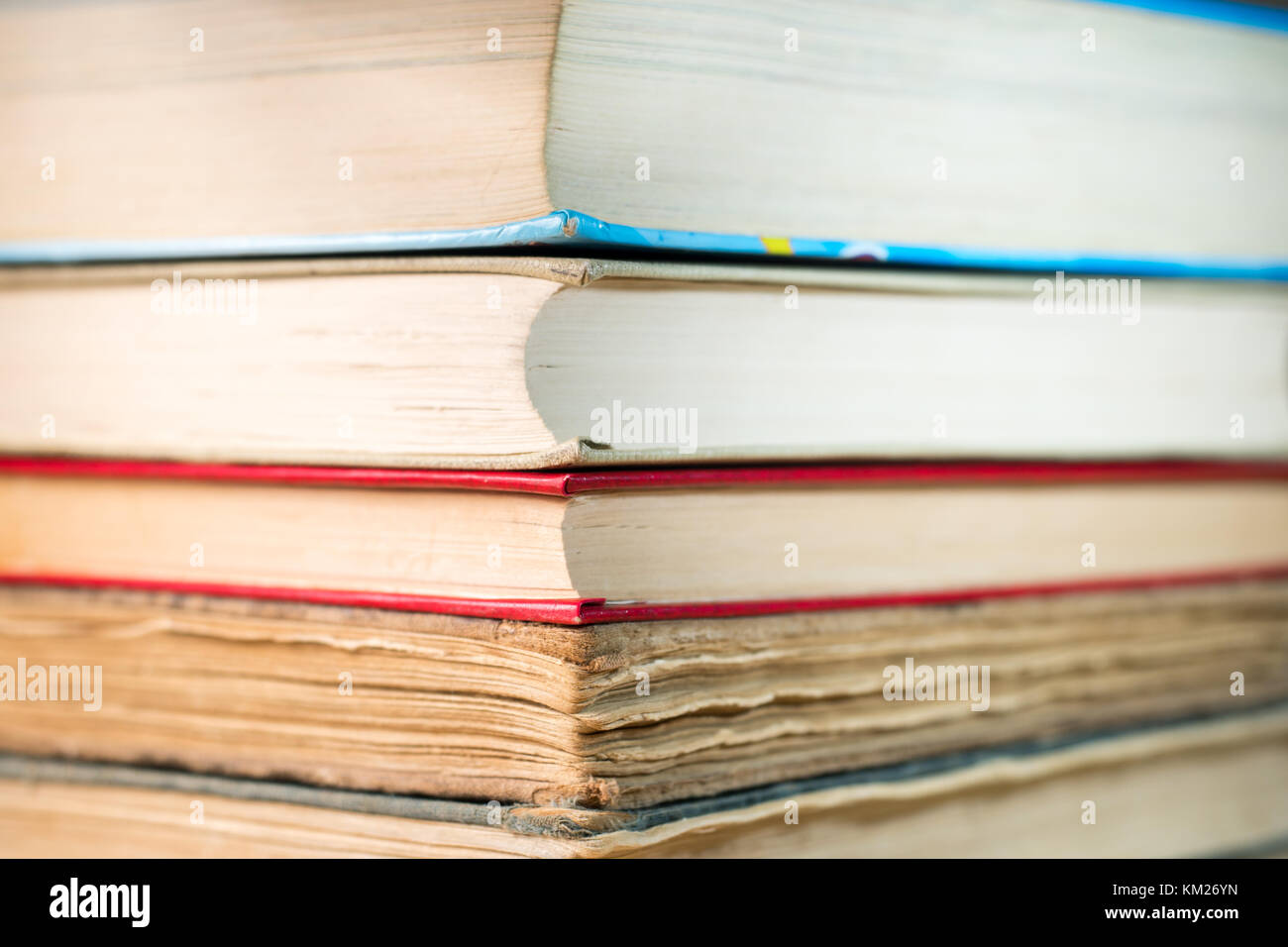 Books stacked on the table. Ancient books. A bunch of old books. art, paper, education, library, literature, old, - Stock Image