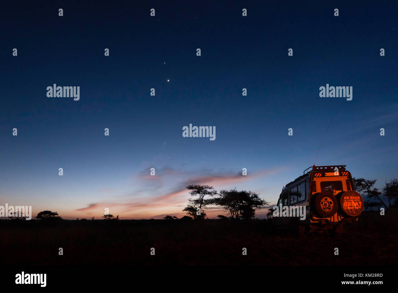 Safari jeep parked at night in the Serengeti, Tanzania - Stock Image