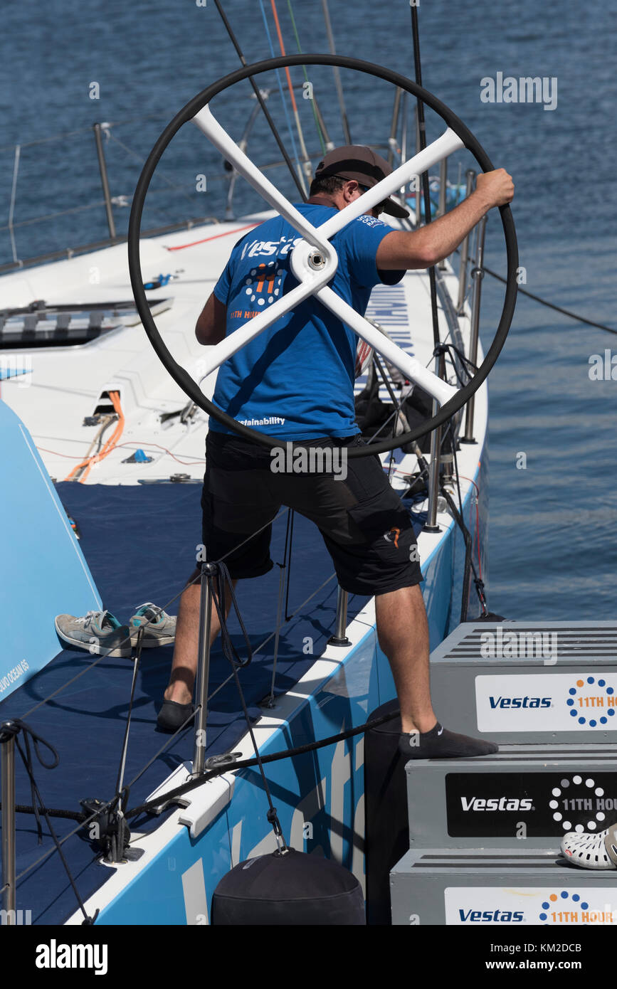 Volvo Ocean Race Cape Town South Africa. Team member of the racing yacht Vestas 11th Hour Racing carrying ashore - Stock Image