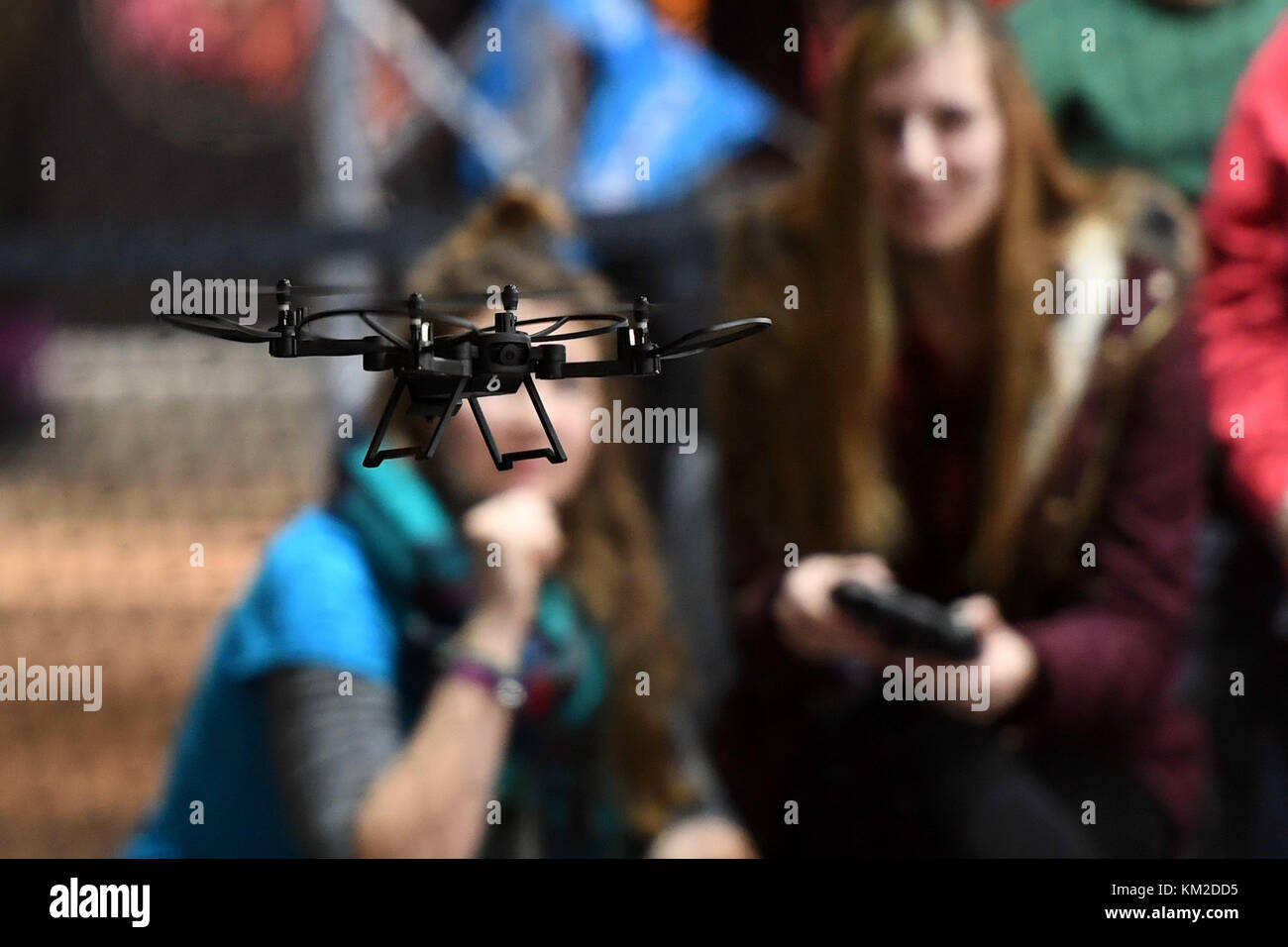 Berlin, Germany. 02nd Dec, 2017. Visitors trying out a drone during the Drone Champions League (DCL) in Berlin, - Stock Image