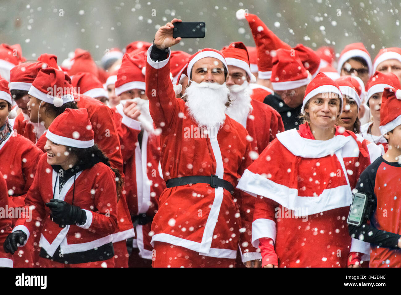 London, UK. 3rd Dec, 2017. Thousands join the annual Santa Run for charitable causes in Victoria Park. Credit: Guy - Stock Image