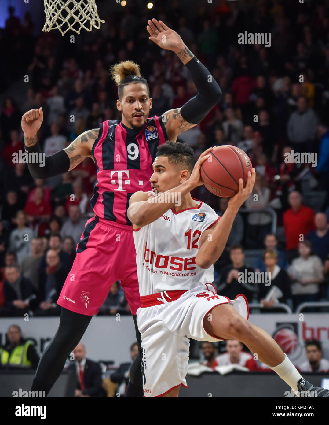 Germany, Bamberg, Brose Arena, 03 December 2017 - (From L-R): Julian GambleÊ (Telekom Baskets Bonn, #9) attempting - Stock Image