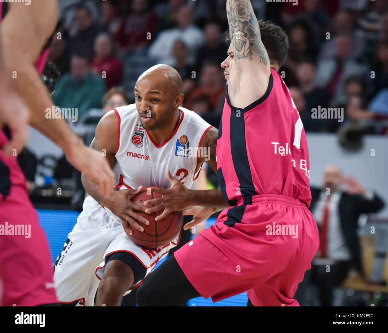 Germany, Bamberg, Brose Arena, 03 December 2017 - (From L-R): Ricky Hickman (Brose Bamberg, #2) making a drive to - Stock Image